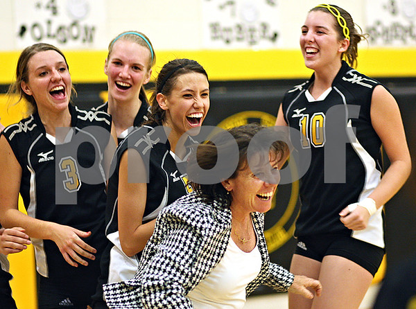 Beck Diefenbach  -  bdiefenbach@daily-chronicle.com<br /> <br /> (From left) Sycamore's Jillian Johnson (3), Evyn McCoy (11), Kaitlyn Roach (5). head coach Debbie Klock and Sarah Verkler (10) celebrate after defeating DeKalb at Sycamore High School in Sycamore, Ill., on Thursday Oct. 15, 2009.