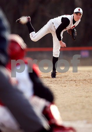 Beck Diefenbach  -  bdiefenbach@daily-chronicle.com<br /> <br /> Indian Creek's Josh Lazzarotto (17) pitches the ball during the bottom of the third inning against Genoa Kingston High School in Genoa, Ill., on Wednesday March 18, 2009.