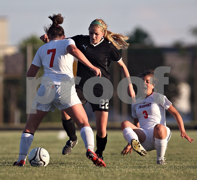Beck Diefenbach  -  bdiefenbach@daily-chronicle.com<br /> <br /> Freeport's Megan Schierer (3) hits the ground as she is passed by Sycamore's Rachel Stueber (22) during the second half of the IHSA Class 2A Sectional final game at Belvidere High School in Belvidere, Ill., on Friday May 29, 2009.