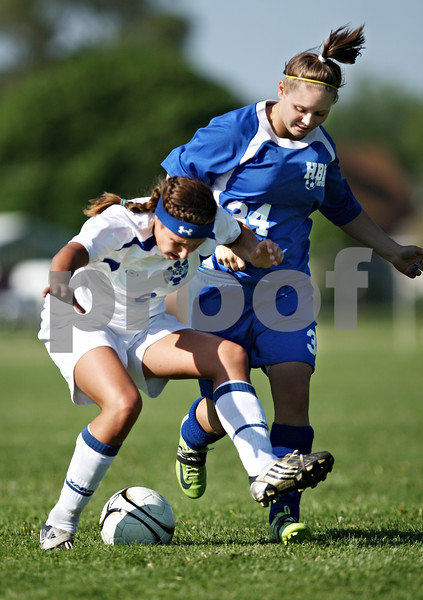 Beck Diefenbach  -  bdiefenbach@daily-chronicle.com<br /> <br /> Hinckley-Big Rock's Brittany Herrmann (34) overpowers Princeton's Katlin Petersen (9) during the first half of the IHSA Class 1A Regional Final game at Indian Creek Middle School in Waterman, Ill., on Tuesday May 19. 2009.