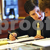 Beck Diefenbach  -  bdiefenbach@daily-chronicle.com<br /> <br /> DeKalb's Classical Conversation mock trial team members (second from right) Joel Dik, 13, and Isaac Chapman, 15, talk amongst themselves during their mock murder trail against the Freeport team at the DeKalb County courthouse in Sycamore, Ill., on Wednesday May 20, 2009.