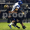 Beck Diefenbach  -  bdiefenbach@daily-chronicle.com<br /> <br /> Geneva's Jacob Landau (2) is taken down by Sycamore's Eric Ray (5, left) and Marckie Hayes (1) during the first quarter of the game at Sycamore High School in Sycamore, Ill., on Friday Sept. 25, 2009.