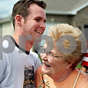 Rob Winner – rwinner@daily-chronicle.com<br /> Brett Bartlett hugs his grandmother Betty Eldridge on Tuesday afternoon at his parents' home in Sycamore. Bartlett who spent time in Afghanistan while serving in the Army returned home Wednesday to a motorcycle escort by the Warriors' Watch Riders from the Des Plaines Oasis to his parents' home in Sycamore.<br /> 08/05/2009<br /> Kate is calling the family to find out his rank...the internet tells me it is Spc., but I'd like confirmation from Kate first.