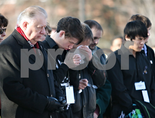 Beck Diefenbach  -  bdiefenbach@daily-chronicle.com<br /> <br /> Norther Illinois University President John Peters joins mourners during the presentation of the memorial wreaths outside Cole Hall on the campus of Northern Illinois University in DeKalb, Ill., on Saturday Feb. 14, 2009.