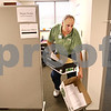 Beck Diefenbach  -  bdiefenbach@daily-chronicle.com<br /> <br /> Don Boyd, of Sycamore, collects paper to be shredded while volunteering at Kishwaukee Hospital in DeKalb, Ill., on Monday Oct. 12, 2009. Boyd began volunteering at the hospital after he lost his job in June.