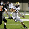 Rob Winner rwinner@daily-chronicle.com<br /> Sycamore's Joe Dougherty (right) slips past Dominik Taylor on his way to Sycamore's first touchdown on Saturday night in DeKalb.<br /> 09/11/2009