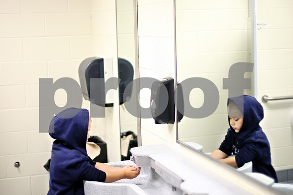 Beck Diefenbach  -  bdiefenbach@daily-chronicle.com<br /> <br /> Second grader Austin Rapier washes his hands before lunch at Kingston Elementary School in Kingston, Ill., on Friday Aug. 21, 2009.