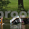 "Beck Diefenbach  -  bdiefenbach@daily-chronicle.com<br /> <br /> Deidre Cwian, left, and Katie Doonan of Lambda Sigma Sorority cannot stay upright in their boat, ""The Maiden,"" made of mostly recycled materials during the lagoon boat race portion of the Northern Illinois' Homecoming week on campus in DeKalb, Ill., on Tuesday Sept. 29, 2009."