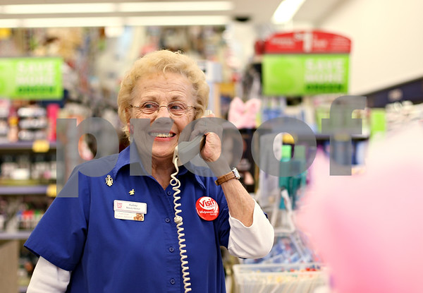 """Beck Diefenbach  -  bdiefenbach@daily-chronicle.com<br /> <br /> """"Come on over to Grandma,"""" Audrey Bundy says when there is no line at her counter in cosmetics at Walgreens in Sycamore, Ill., on Friday Oct. 9, 2009."""