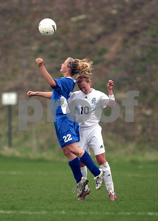 Beck Diefenbach  -  bdiefenbach@daily-chronicle.com<br /> <br /> Hinckley-Big Rock's Maxzine Rossler (22) heads the ball above Kaneland's Colleen Gebauer (10) during the second half of the game at Kaneland High School in Maple Park, Ill., on Wednesday April 29, 2009.
