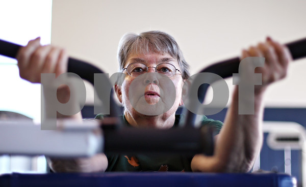 Beck Diefenbach  -  bdiefenbach@daily-chronicle.com<br /> <br /> Corki Williams, of Sycamore, works her arms during her circuit training class at the Kishwaukee YMCA in Sycamore, Ill., on Wednesday April 15, 2009.