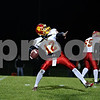 Rob Winner – rwinner@daily-chronicle.com<br /> <br /> Batavia quarterback Noel Gaspari looks to launch a deep ball during the first half.<br /> <br /> 10/09/2009