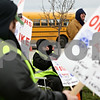 Rob Winner – rwinner@daily-chronicle.com<br /> Picketers including school bus driver Ken Erwin (center) gathered in front of the First Student bus yard on Monday morning. Bus drivers for DeKalb School District 428 went on strike Monday morning after voting down a proposed contract from First Student.<br /> 11/16/2009