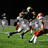 Rob Winner – rwinner@daily-chronicle.com<br /> <br /> Sycamore running back Marckie Hayes heads for the end zone as time expires in the first half. Hayes nearly scored but was tackled just before the goal line.<br /> <br /> 10/09/2009