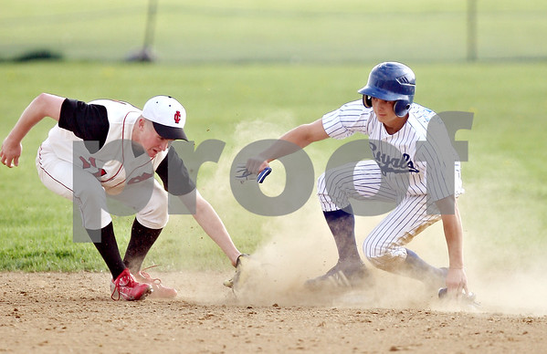 Beck Diefenbach  -  bdiefenbach@daily-chronicle.com<br /> <br /> Indian Creek's Cal Herman (21) can't catch Hinckley-Big Rock's Jake Paver (36) as he steals second base during the third inning of game at HBR High School in Hinckley, Ill., on Tuesday May 5, 2009.