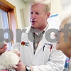 "Beck Diefenbach – bdiefenbach@daily-chronicle.com<br /> <br /> Dr. David Emmert dispenses anit-inflammatory eye drops into the eye of Lola, a 3 year old maltese poodle, as her owner, Jean Talbert, of DeKalb, watches at Prairie View Animal Hospital in DeKalb, Ill., on Thursday March 5, 2009. Talbert took Lola in for protruding eye lid called ""cherry eye."""