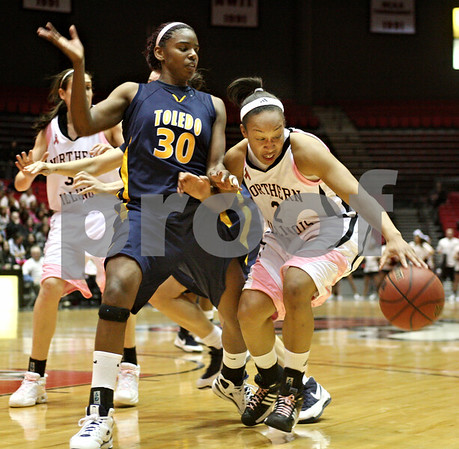 Beck Diefenbach – bdiefenbach@daily-chronicle.com<br /> <br /> Northern Illinois guard Shari' Welton (2) tries to get around Toledo forward Tanika Mays (30) during the first half of the game at the Convocation Center in DeKalb, Ill., on Tuesday Feb. 24, 2009.