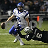 Beck Diefenbach  -  bdiefenbach@daily-chronicle.com<br /> <br /> Geneva quarterback Brandon Beitzel (6) is sacked by Kaneland linebacker Tyler Callaghan (6) during the first quarter of the game at Kaneland High School in Maple Park, Ill., on Friday Oct. 16, 2009.