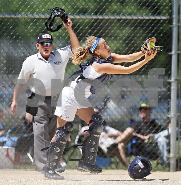 Beck Diefenbach  -  bdiefenbach@daily-chronicle.com<br /> <br /> Kishwaukee Valley Storm catcher Jennifer Clark (6) catches a pop-fly during the 18-under game against the St. Charles Comets during Storm Dayz in Sycamore, Ill., on Sunday June 28, 2009.