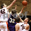 Beck Diefenbach  -  bdiefenbach@daily-chronicle.com<br /> <br /> DeKalb's Jordan Threloff (42, left) blocks a shot by Hampshire Shyler Ralphs (32, center) during the fourth quarter of the game at DeKalb High School on Tuesday Dec. 22, 2009. DeKalb defeated Hampshire 58 to 50.