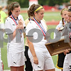 Beck Diefenbach  -  bdiefenbach@daily-chronicle.com<br /> <br /> (From left) Sycamore's Krista Koeplin, Kaitlin Harnden, Brianna Henke and Nici Newquist look at their fourth place trophy after they lost the Class 2A third place tournament game against Cathum Glenwood at North Central College in Naperville, Ill., on Saturday June 6, 2009.