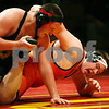 Rob Winner – rwinner@daily-chronicle.com<br /> Rob Winner – rwinner@kcchronicle.com<br /> Batavia's Pat Martin (left) takes on DeKalb's Alex Robinson during the first match on Thursday night in Batavia.<br /> 12/03/2009 <br /> 275 lbs.
