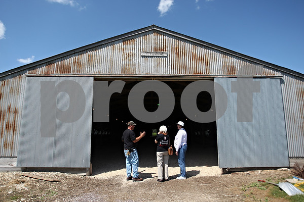 Beck Diefenbach  -  bdiefenbach@daily-chronicle.com<br /> <br /> Ha-Ok Turkey Farm owner Robert Kauffman, left, shows off one of his turkey pens during a tour of his facilities in Waterman Ill., for the How Green Really Works: A Meeting Planner's Workshop on Wednesday July 29, 2009.