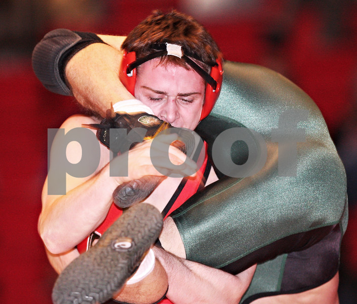 Beck Diefenbach  -  bdiefenbach@daily-chronicle.com<br /> <br /> Northern Illinois' Steve Zimmerman holds onto the legs and feet of Ohio's Kevin Christensen during the 149 weight class of the match at the Convocation Center at NIU in DeKalb, Ill., on Thursday Jan. 15, 2009. Ohio beat NIU 23 to 22.