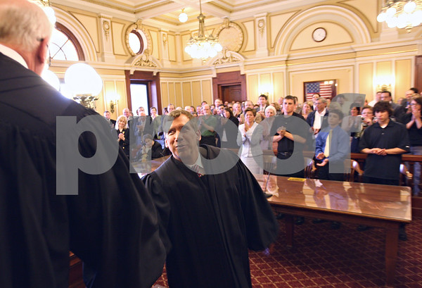 Beck Diefenbach  -  bdiefenbach@daily-chronicle.com<br /> <br /> Associate Judge Ron Matekaitis is congratulated after being sworn in at the DeKalb County Court House in Sycamore, Ill., on Friday May 1, 2008.