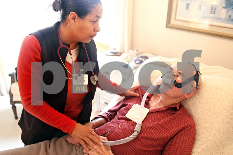 Beck Diefenbach  -  bdiefenbach@daily-chronicle.com<br /> <br /> Registered nurse Sharon Wells, of DeKalb County Hospice, talks with Jim Willrett, an ALS patient, about his eating habits at his home in Malta, Ill., on Thursday Oct. 16, 2009.
