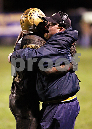 Beck Diefenbach  -  bdiefenbach@daily-chronicle.com<br /> <br /> Hiawatha runningback Angel Hernandez (11) embraces head coach Sean Donnelly after he surpassed 1000 yards in the season during the second quarter of the game against North Shore Country Day School at Hiawatha High School in Kirkland, Ill., on Friday Oct. 23, 2009.
