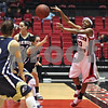 Beck Diefenbach  -  bdiefenbach@daily-chronicle.com<br /> <br /> Northern Illinois Marke Freeman (23) nearly falls out of bounds as she passes the ball during the first half of the game against Akron at Northern Illinois' Convocation Center in DeKalb, Ill., on Wednesday Feb. 4, 2009.
