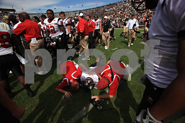 Beck Diefenbach – bdiefenbach@daily-chronicle.com<br /> <br /> Northern Illinois' Jake Coffman (54) lays on the ground following the defeat of Purdue University in West Lafayette, Ind., on Saturday Sept. 19, 2009
