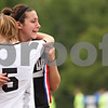 Beck Diefenbach  -  bdiefenbach@daily-chronicle.com<br /> <br /> Sycamore's Nici Newquist (right) embraces Krista Koeplin (left) after they lost the Class 2A third place tournament game against Cathum Glenwood at North Central College in Naperville, Ill., on Saturday June 6, 2009. Sycamore lost 1 to 2, taking fourth place in the tournament.