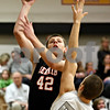 Rob Winner – rwinner@daily-chronicle.com<br /> Rob Winner – rwinner@kcchronicle.com<br /> DeKalb's Jordan Threloff takes a shot over Kaneland's Dave Dudzinski during the first quarter.<br /> 12/04/2009
