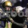 Beck Diefenbach  -  bdiefenbach@daily-chronicle.com<br /> <br /> Hiawatha guard Brett Peterson (54) attempts to strip the ball from the hands of North Shore Country Day School runningback Carlos Hunter (43) during the second quarter of the game at Hiawatha High School in Kirkland, Ill., on Friday Oct. 23, 2009.
