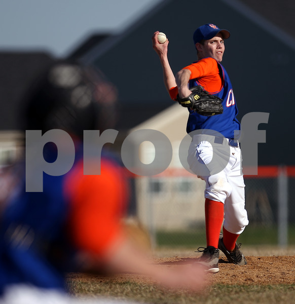 Beck Diefenbach  -  bdiefenbach@daily-chronicle.com<br /> <br /> Genoa Kingston's starting pitcher Cody winds up during the top of the third inning against Burlington Central at GK High School in Genoa, Ill., on Friday April 17, 2009.