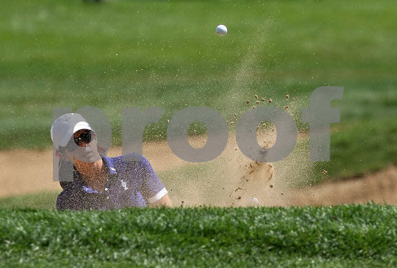 Beck Diefenbach  -  bdiefenbach@daily-chronicle.com<br /> <br /> USA's Nicole Castrale chips out of a bunker on the 10th hole during the match against team Europe at the Solheim Cup in Sugar Grove, Ill., on Saturday Aug. 22, 2009.