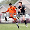 Beck Diefenbach  -  bdiefenbach@daily-chronicle.com<br /> <br /> DeKalb's Ramon Camacho (4, left) and Kaneland's Derek White (7) battle over a ball during the first half of the game at DeKalb High School in DeKalb, Ill., on Monday Sept. 28, 2009.