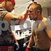 Beck Diefenbach  -  bdiefenbach@daily-chronicle.com<br /> <br /> Steven Kick (right), 18, of Sandwich, Ill., gets gel applied to his face by teammate Daniel Vizcaya before entering the cage for his match in Power Fights 14, an amateur cage-fighting mixed-martial arts event at the Timber Creek Inn and Suites, in Sandwich, on Saturday Oct. 21, 2009. The gel helps reduce cuts and bleeding from the friction of the gloves.