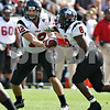 Beck Diefenbach – bdiefenbach@daily-chronicle.com<br /> <br /> Northern Illinois' quarterback Chandler Harnish (12) hands the ball off to runningback Me'co Brown (8) during the first half of the game against Purdue University in West Lafayette, Ind., on Saturday Sept. 19, 2009