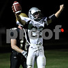 Rob Winner –  rwinner@daily-chronicle.com<br /> Kaneland's Quinn Buschbacher celebrates his touchdown in the first half of Friday night's game in Sycamore.<br /> 09/18/2009