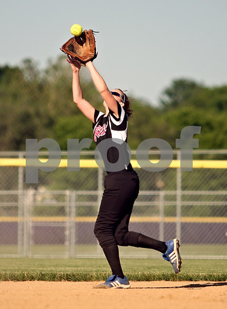 Beck Diefenbach  -  bdiefenbach@daily-chronicle.com<br /> <br /> Burlington Central's Katie Maleski (11) catches a pop fly during the top of the seventh inning of the Class 3A Rochelle Sectional semi-final game at Rochelle High School in Rochelle, Ill., on Wednesday June 3, 2009.