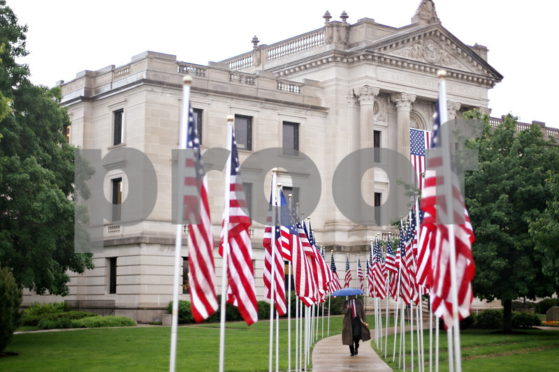 Beck Diefenbach  -  bdiefenbach@daily-chronicle.com<br /> <br /> Flags are lined up outside the DeKalb County Courthouse in preparation for the return of the Sycamore National Guard Unit in Sycamore, Ill., on Monday June 1, 2009.