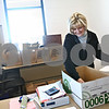 Beck Diefenbach  -  bdiefenbach@daily-chronicle.com<br /> <br /> Patient Care Coordinator Kathy Condon unpacks boxes in he new office at the new Community Outreach Building at 2500 N. Annie Glidden Road in DeKalb, Ill., on Tuesday Jan. 13, 2008. Condon expects better communication with nurses now that she has her own enclosed office.