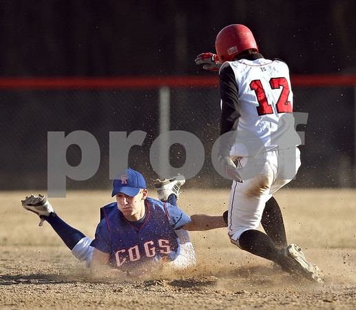 Beck Diefenbach  -  bdiefenbach@daily-chronicle.com<br /> <br /> Indian Creek's Josh Johnson (12) slides in safe at second base before Genoa Kingston's Jackson Kettner (1) can tag him during the top of the fourth inning at GK High School in Genoa, Ill., on Wednesday March 18, 2009.