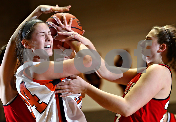 Beck Diefenbach  -  bdiefenbach@daily-chronicle.com<br /> <br /> DeKalb guard forward Emily Murphy (34, left) struggles for control of the ball against Yorkville forward Kourtney Mizel (24) during the first quarter of the game at DeKalb High School in DeKalb, Ill., on Tuesday Jan 13, 2008.