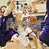 Beck Diefenbach  -  bdiefenbach@daily-chronicle.com<br /> <br /> Rockford Lutheran guard Eric Widstrom (2) guards Genoa-Kingston guard Nick Lopez (22) as he drives to the basket during the second quarter of the game at GK in Genoa, Ill., on Friday Jan. 16, 2009. Lutheran beat GK 46 to 39.