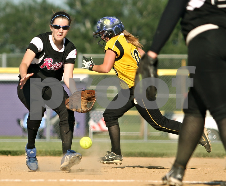Beck Diefenbach  -  bdiefenbach@daily-chronicle.com<br /> <br /> Burlington Central's Katie Maleski (11) feilds a ground ball as Sycamore's Jamie Breitweiser (10) runs for second base during the top of the sixth inning of the Class 3A Rochelle Sectional semi-final game at Rochelle High School in Rochelle, Ill., on Wednesday June 3, 2009.
