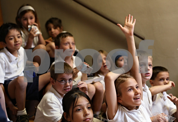 Beck Diefenbach  -  bdiefenbach@daily-chronicle.com<br /> <br /> Third grader Elizabeth Lascala raises her hand to answer a question during the St. Mary's lunchtime prayer group at St. Mary's Catholic school in Sycamore, Ill., on Friday May 22, 2009.